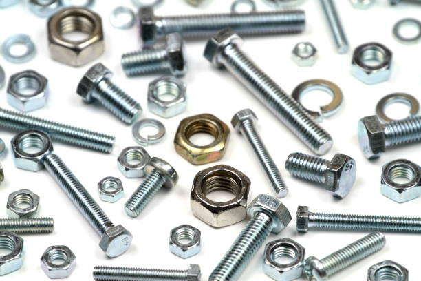 Various bolts, nuts, and washers Various bolts, nuts, and washers on white background. washer fastener stock pictures, royalty-free photos & images