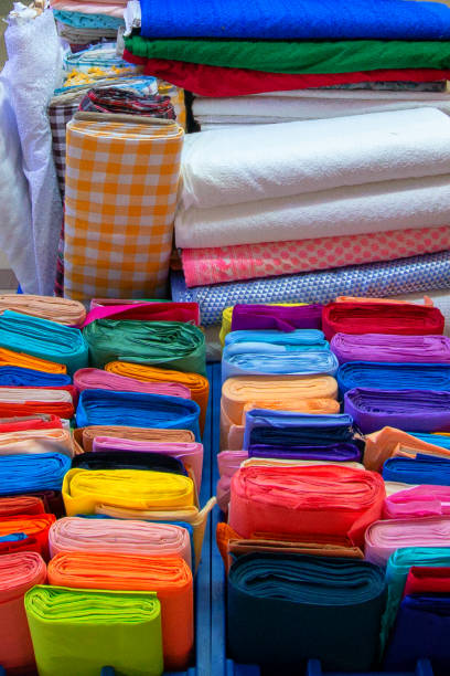 Various bolts / rolls of fabric in Pettah Market in Colombo Sri Lanka Asia stock photo