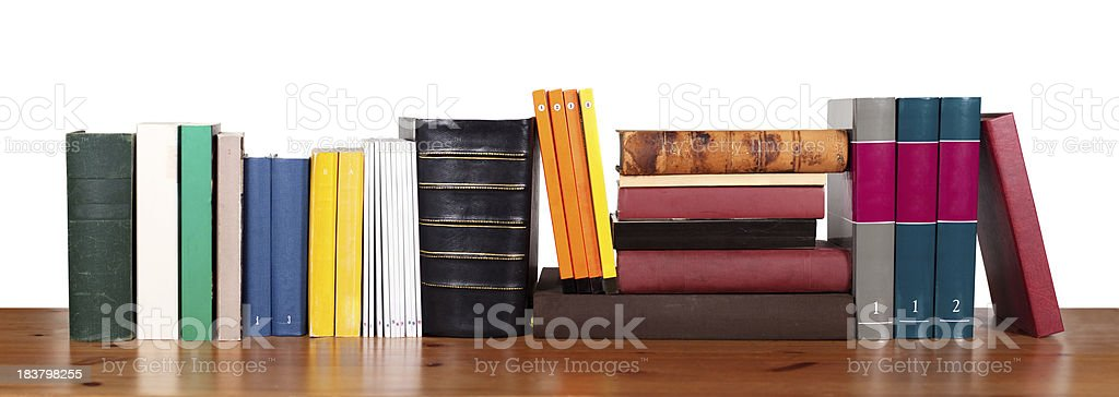 Various books in a row stock photo