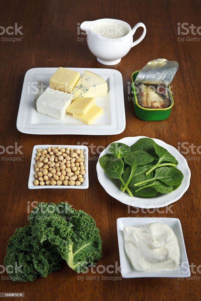Various bowls of food sources of calcium royalty-free stock photo