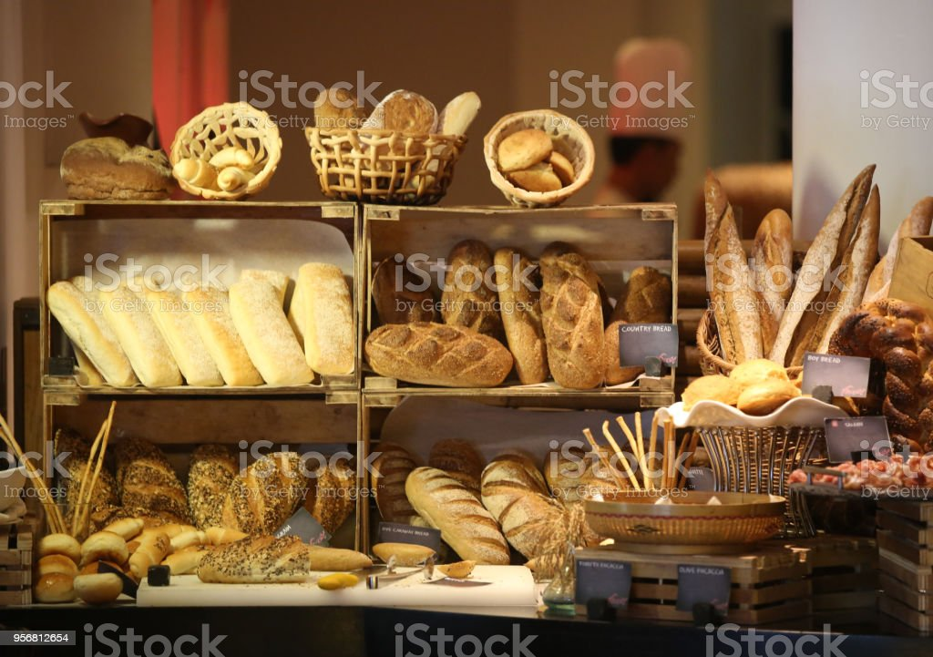 Various breads display on the wooden shelves stock photo
