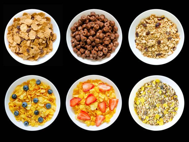 verschiedene frühstück zerealien - haferflocken rosinen stock-fotos und bilder