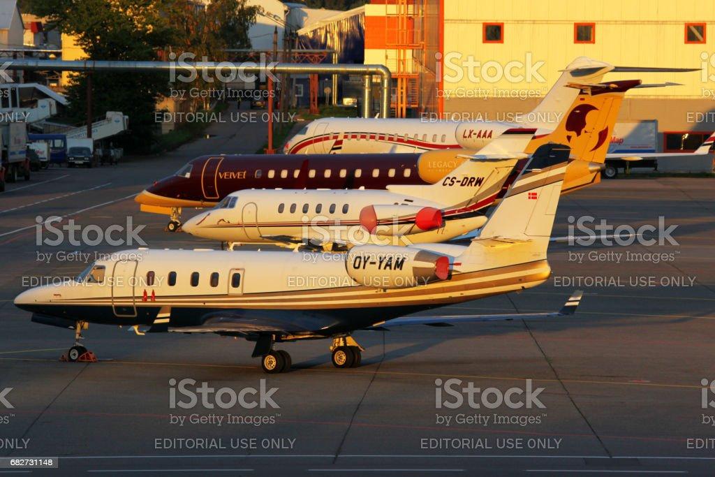 Various business jets standing at Sheremetyevo international airport. stock photo