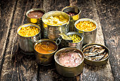 istock Various canned vegetables, meat, fish and fruits in tin cans. 904056852