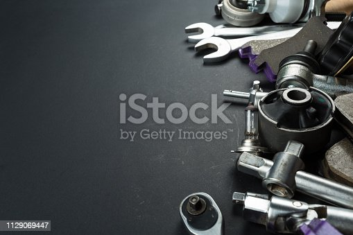 1131085300 istock photo Various Car parts on dark background 1129069447
