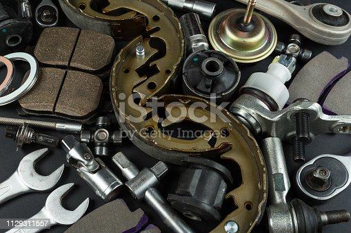 1131085300 istock photo Various Car parts on dark background 1129311557