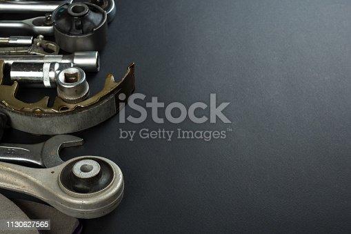 1131085300 istock photo Various Car parts on dark background 1130627565