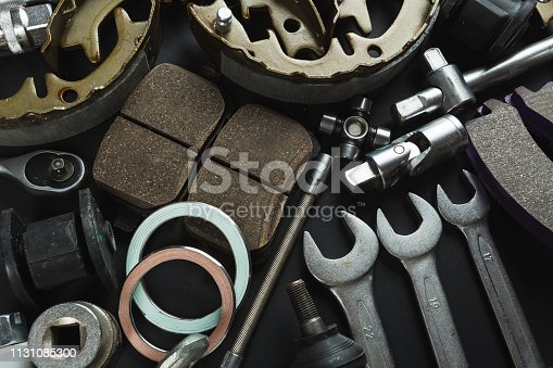 Various Car parts on dark background