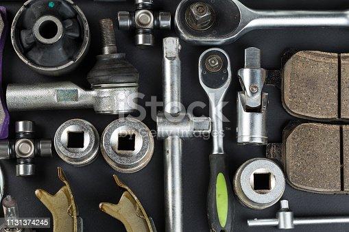 1131085300 istock photo Various Car parts on dark background 1131374245