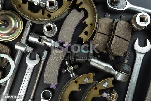 1131085300 istock photo Various Car parts on dark background 1132211661