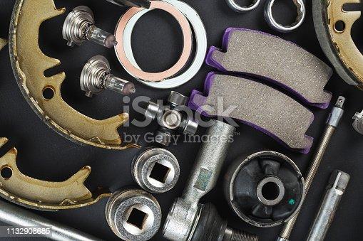 1131085300 istock photo Various Car parts on dark background 1132908685