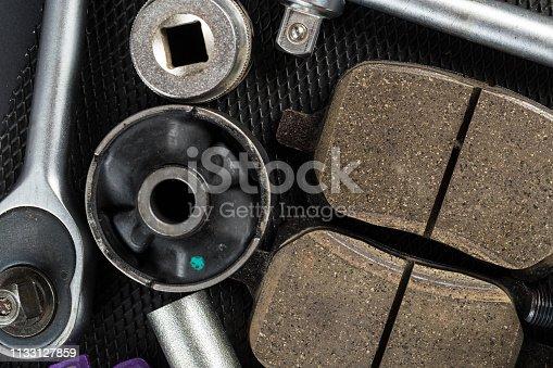 1131085300 istock photo Various Car parts on dark background 1133127859