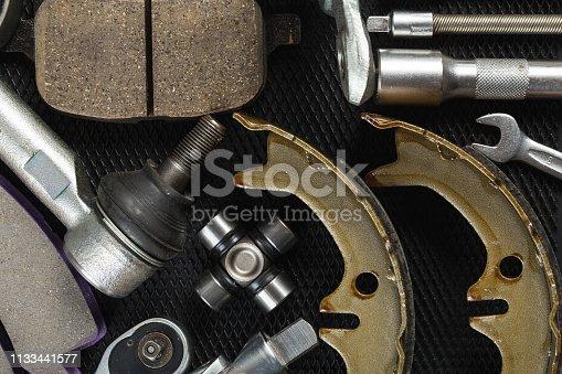 1131085300 istock photo Various Car parts on dark background 1133441577