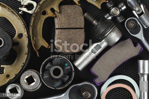 1131085300 istock photo Various Car parts on dark background 1134294165