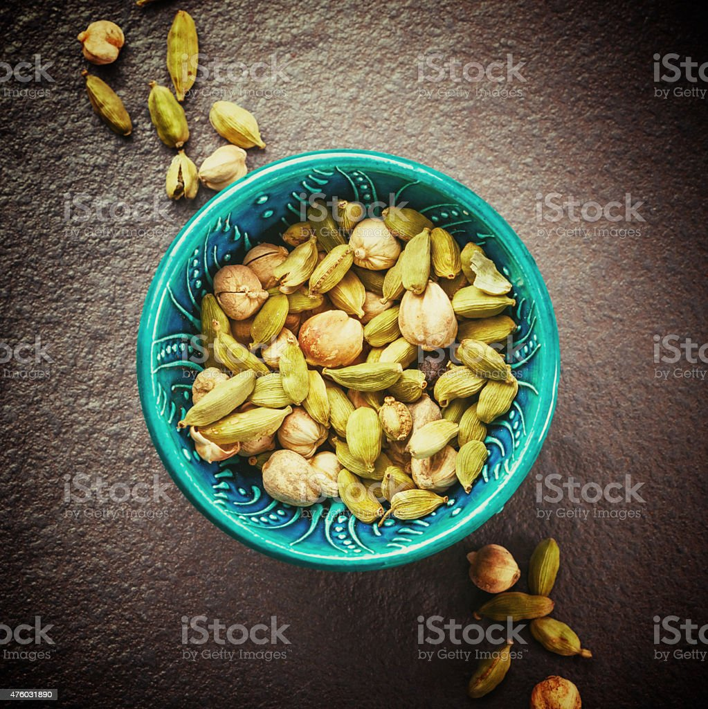 Various Cardamom Spices in Authentic Turkish Bowl stock photo