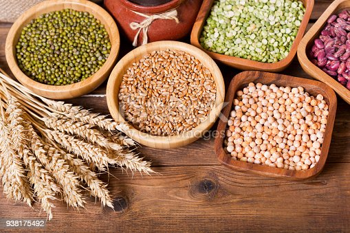 Various Cereals Seeds Beans And Grains On Wooden Table Stock Photo & More Pictures of Barley