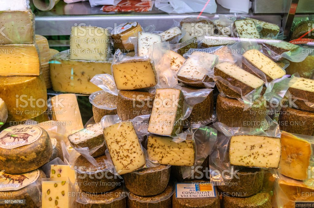 Various cheeses in the Central Market of Valencia, Spain stock photo