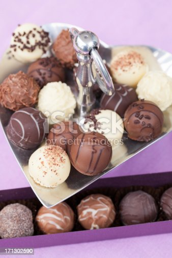 183269671 istock photo Various chocolate truffles on metal tray and in a box 171302590