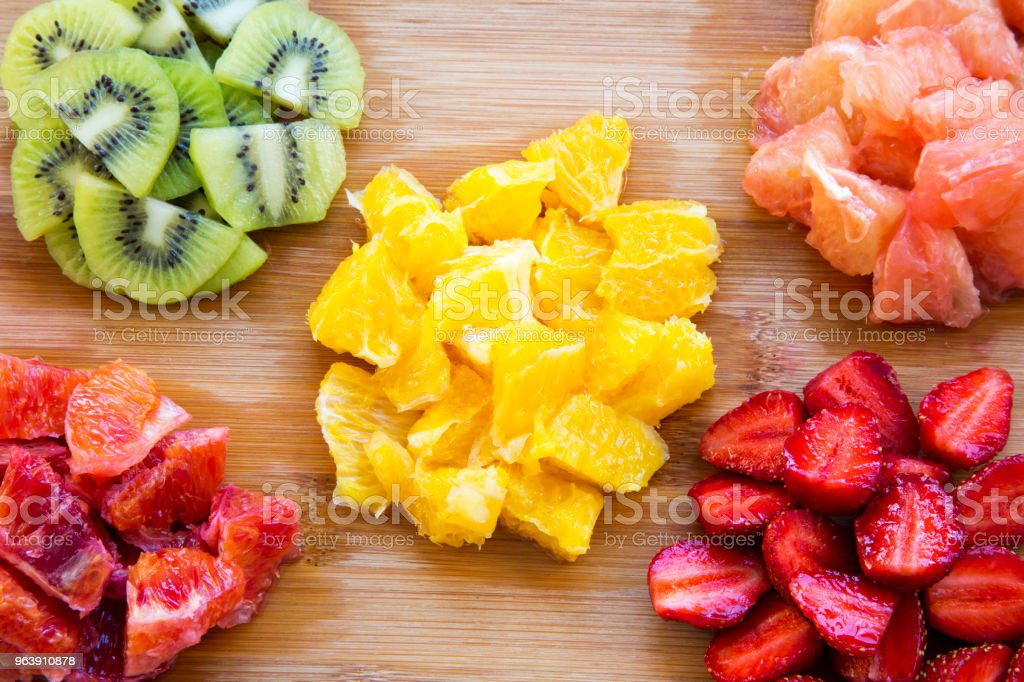 Various chopped fruits on wooden background, top view. Flat lay. From above. - Royalty-free Berry Stock Photo