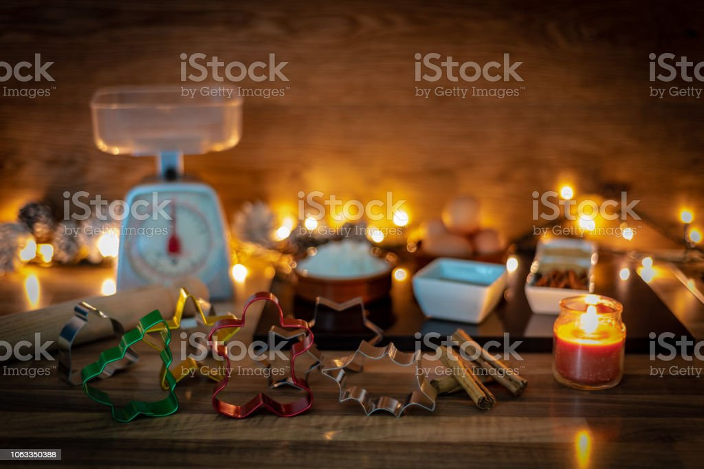 Various Christmas shaped cookie cutters and ingredients stock photo