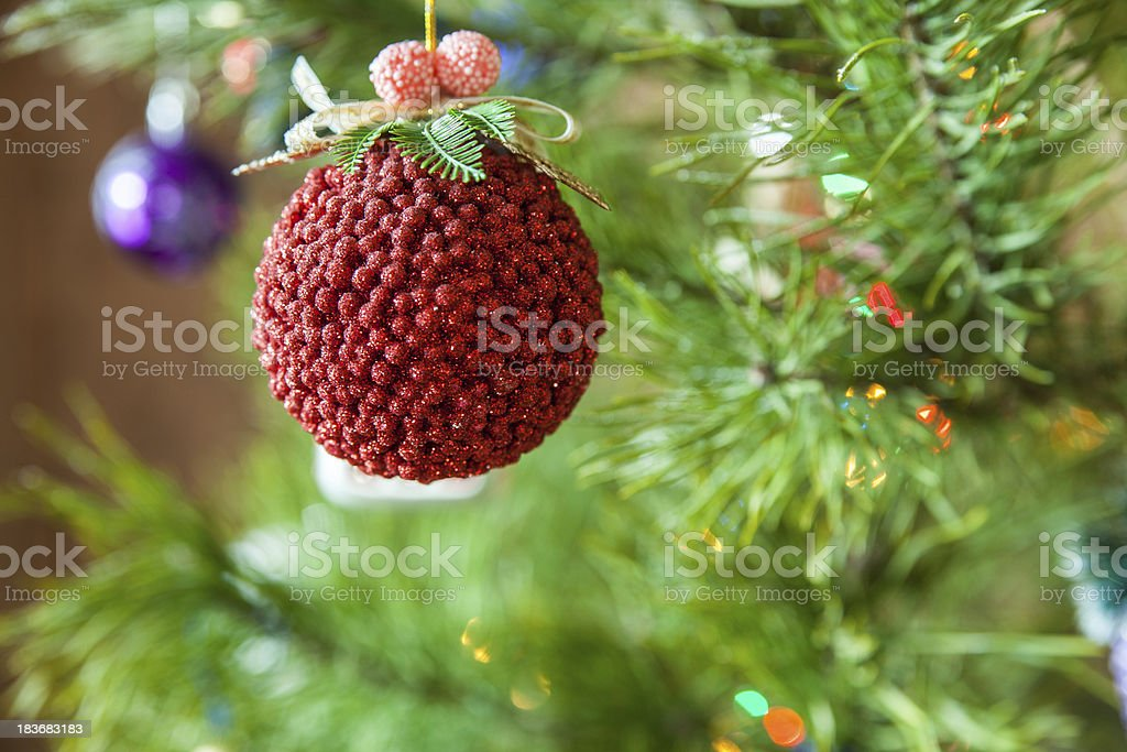 Various Christmas toys on a decorated evergreen tree royalty-free stock photo