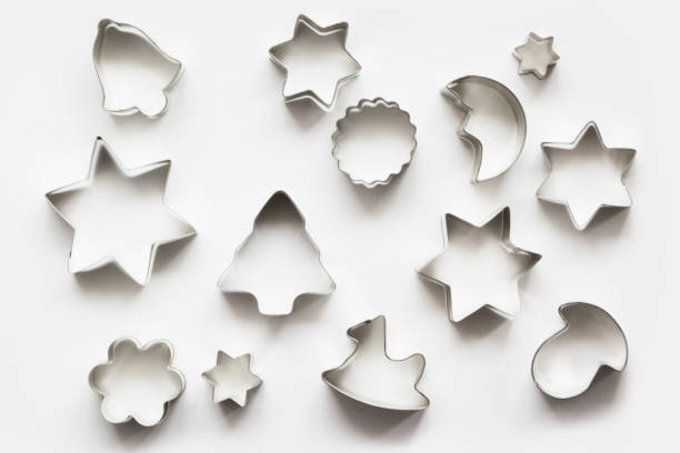Various Christmas-themed cookie cutters.Christmas cookie cutters on white. Holiday card. Various Christmas-themed cookie cutters.Christmas cookie cutters on white. Holiday pattern. cookie cutter stock pictures, royalty-free photos & images