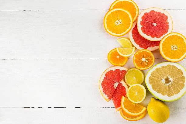 Various citrus on white wooden background Various citrus on white wooden background citrus fruit stock pictures, royalty-free photos & images