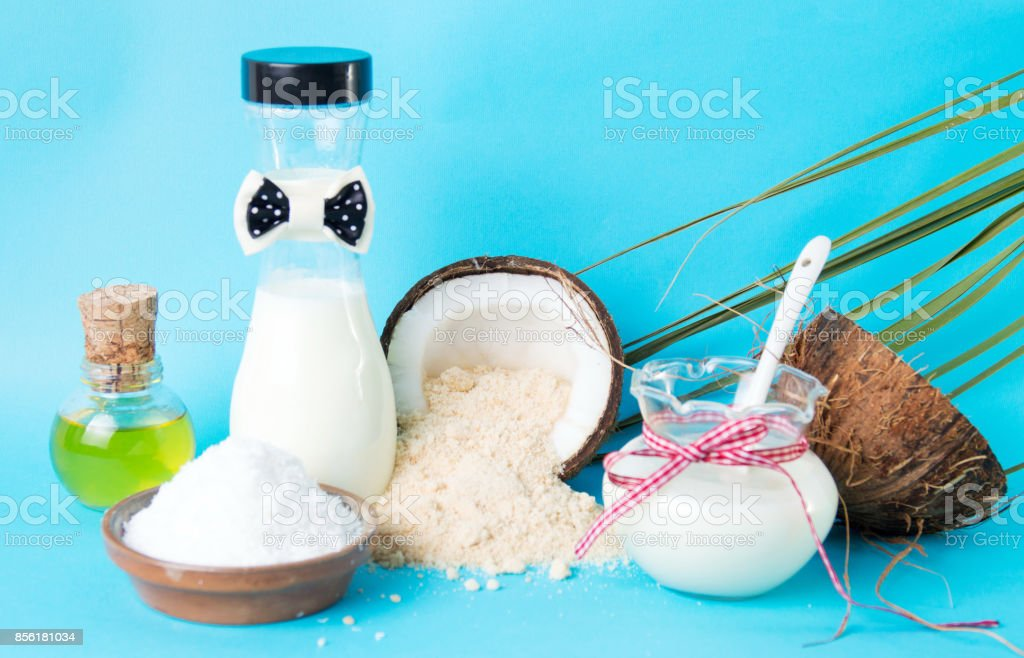 Various coconut products against blue background stock photo