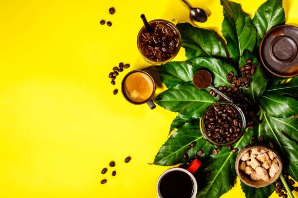 Various coffee on yellow background stock photo