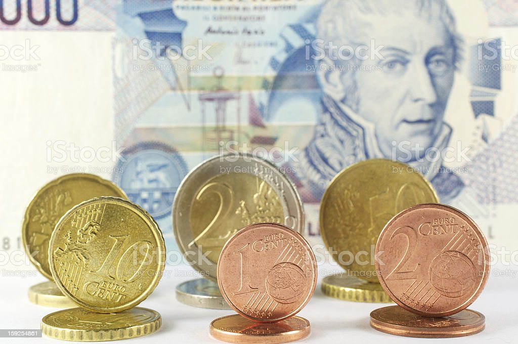 various coins euro and banknote for ten thousand lire royalty-free stock photo
