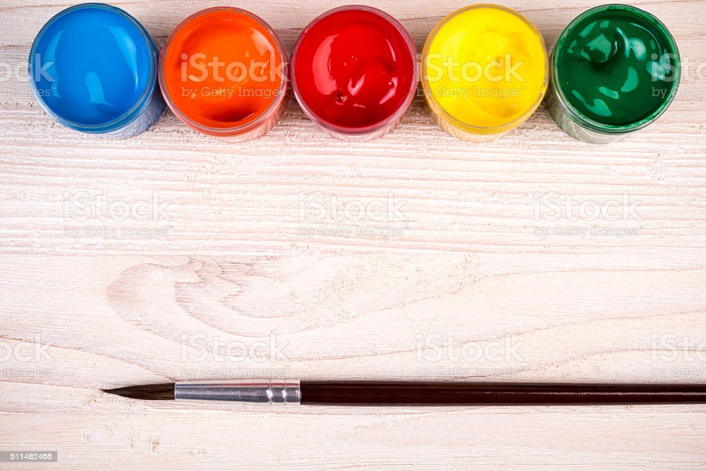 Various color paints with brush stock photo
