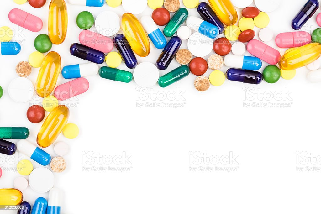 Various color pills and capsules stock photo