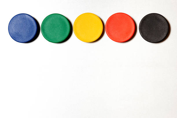 Various colored magnets on metal wall with copy space Various colored magnets on metal wall with copy space magnet stock pictures, royalty-free photos & images