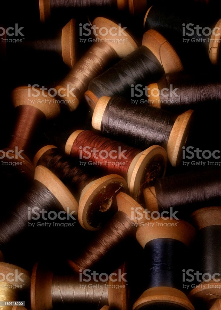 Various colored wooden spools of thread royalty-free stock photo
