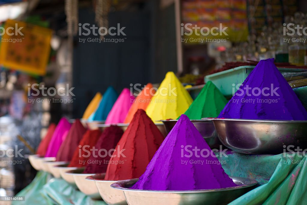 Various colorful mounds of powder in bowls royalty-free stock photo