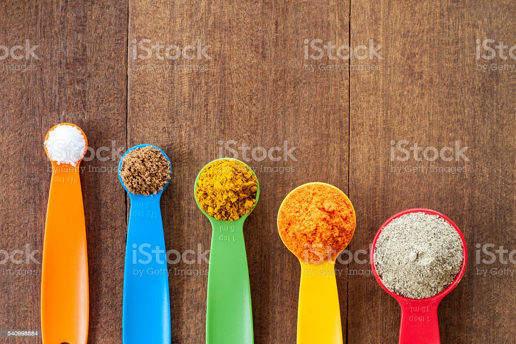 Various colorful spices on wooden table stock photo