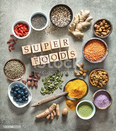 1005962360 istock photo Various colorful superfoods in bowls 1005962222