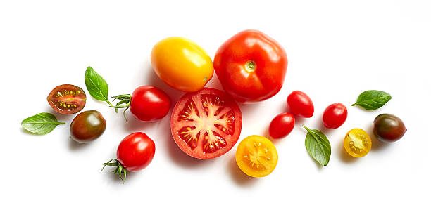 various colorful tomatoes - basil stock photos and pictures