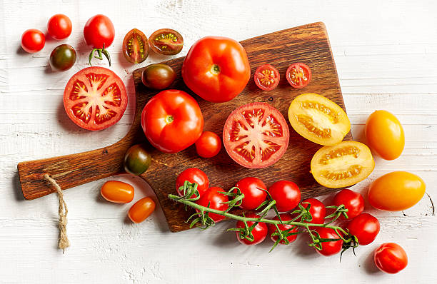 various colorful tomatoes stock photo