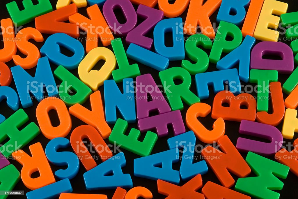 Various colors of alphabet pieces isolated on black royalty-free stock photo