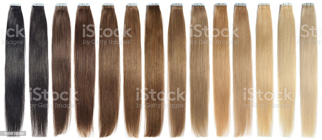 various colors of straight adhesive tape in human hair extensions - foto de acervo
