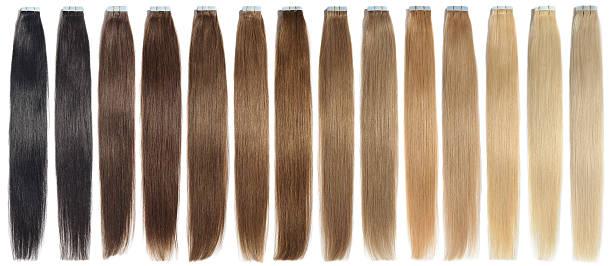 various colors of straight adhesive tape in human hair extensions - haarverlängerung stock-fotos und bilder