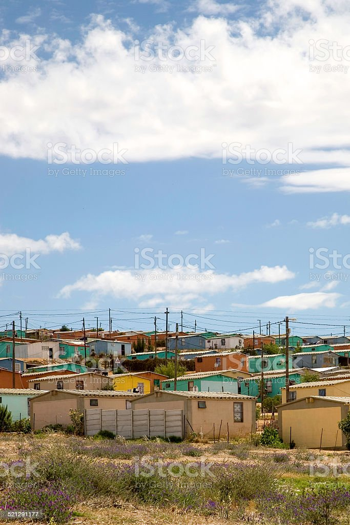 Various coloured houses in a township stock photo