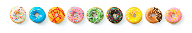 Various colourful donuts in a row stock photo