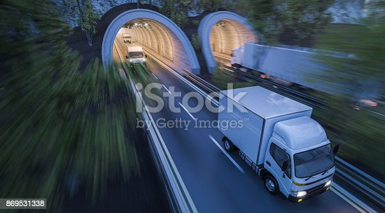 istock Various Commercial Vehicles Moving through Tunnels 869531338