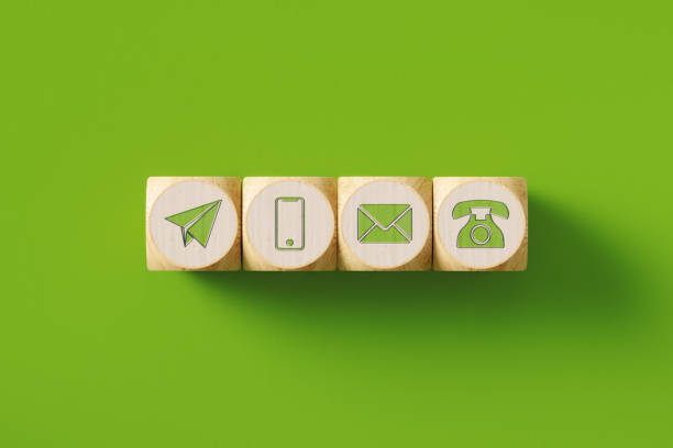 various contact us icons drawn wood blocks sitting on green background - shifts call centre foto e immagini stock