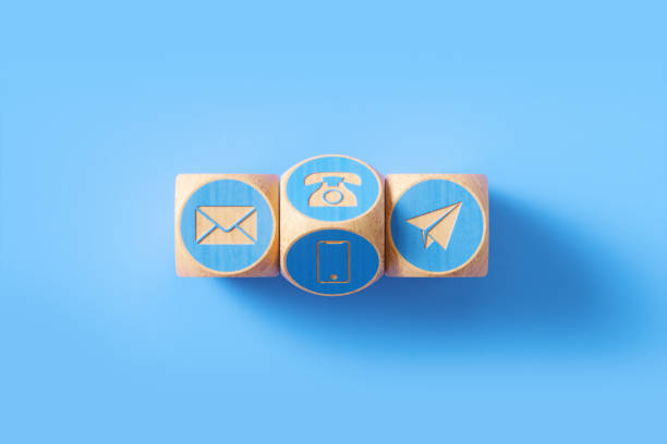 various contact us symbols drawn blue wood blocks sitting on blue background - shifts call centre foto e immagini stock