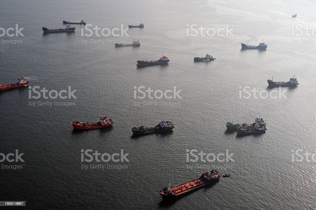 Various container ships are out on the ocean stock photo
