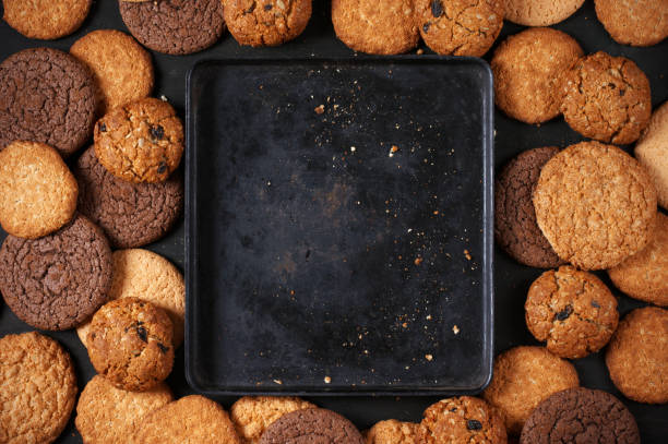 various cookies and baking pan - bakplåt bildbanksfoton och bilder