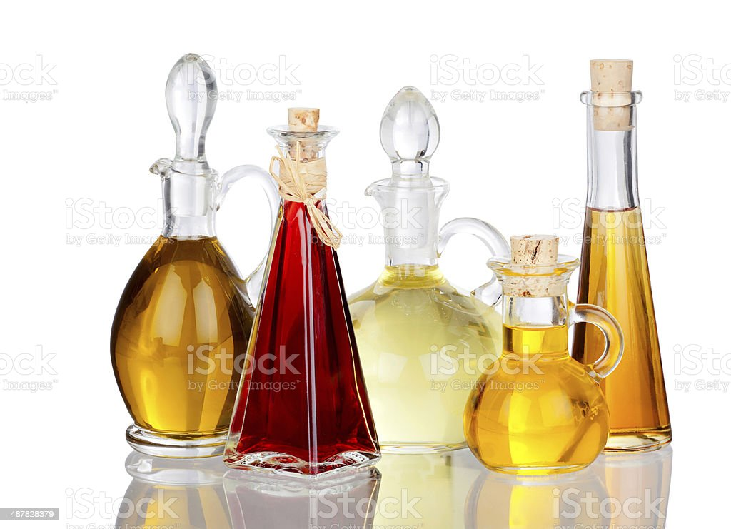 Various Cooking Oils in Glass carafes with real reflection stock photo